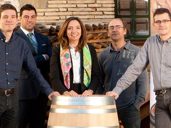 elena murua and team with barrel